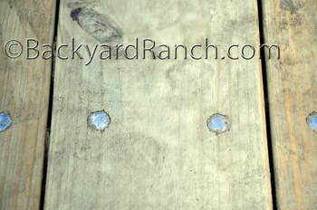 Horse trailer repair - replacing bolts in floor with galvanized bolts.